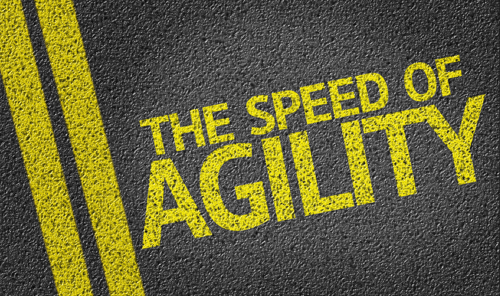 The Speed of Agility written on the road